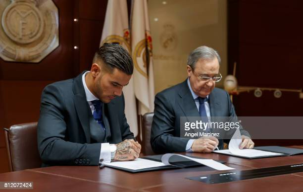 Theo Hernandez of Real Madrid signs his contract beside President Florentino Perez during his official presentation at Estadio Santiago Bernabeu on...