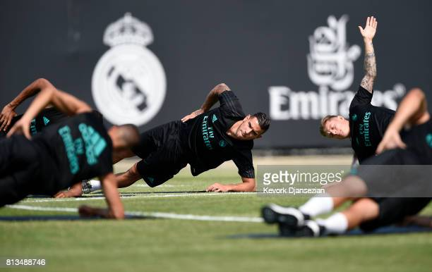 Theo Hernandez of the Real Madrid stretches during training for Tour 2017 on the campus of UCLA July 12 in Los Angeles California