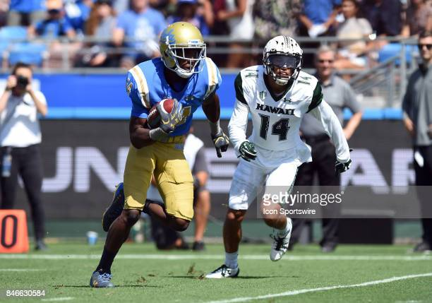 Theo Howard runs the ball for a touchdown during a college football game between the Hawai'i Rainbow Warriors and the UCLA Bruins on September 09...