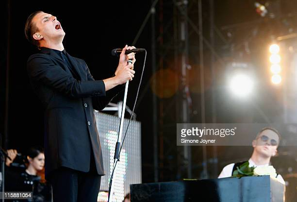 Theo Hutchcraft and Adam Anderson of Hurts perform live on the main stage during day two of the Isle of Wight Festival 2011 at Seaclose Park on June...