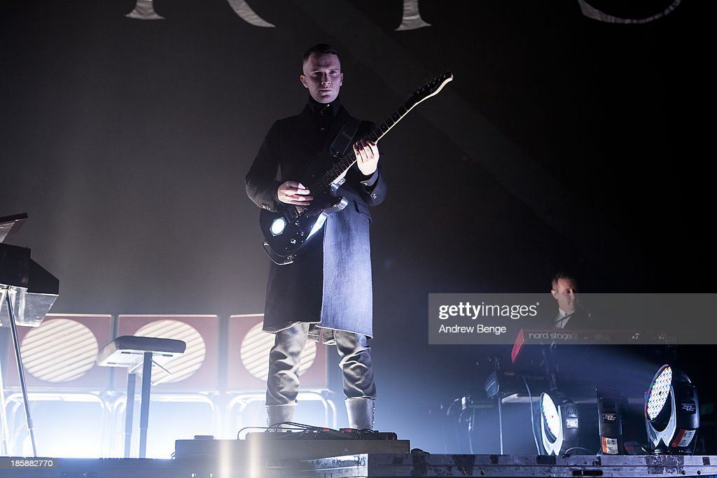 Theo Hutchcraft and Adam Anderson of Hurts perform on stage at Manchester Apollo on October 25, 2013 in Manchester, England.