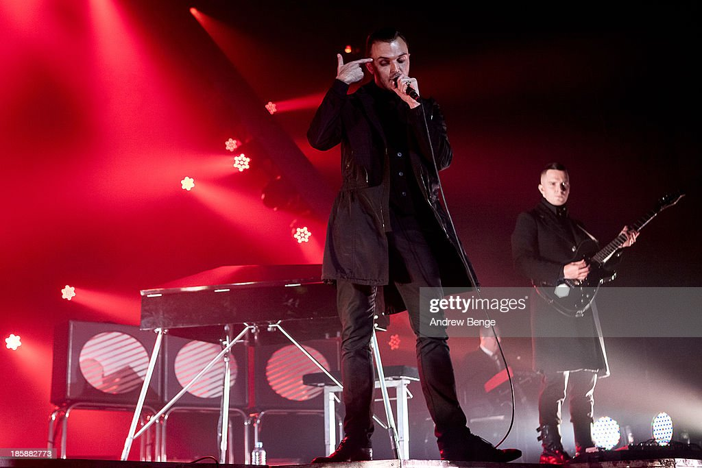 <a gi-track='captionPersonalityLinkClicked' href=/galleries/search?phrase=Theo+Hutchcraft&family=editorial&specificpeople=6963475 ng-click='$event.stopPropagation()'>Theo Hutchcraft</a> and Adam Anderson of Hurts perform on stage at Manchester Apollo on October 25, 2013 in Manchester, England.