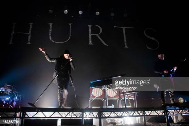 Theo Hutchcraft and Adam Anderson of Hurts perform on stage at Manchester Apollo on October 25 2013 in Manchester England
