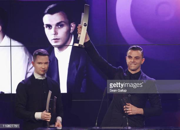 Theo Hutchcraft and Adam Anderson of Hurts receive their Most Successful Newcomer Of The Year International Award at the Echo Awards 2011 at Palais...