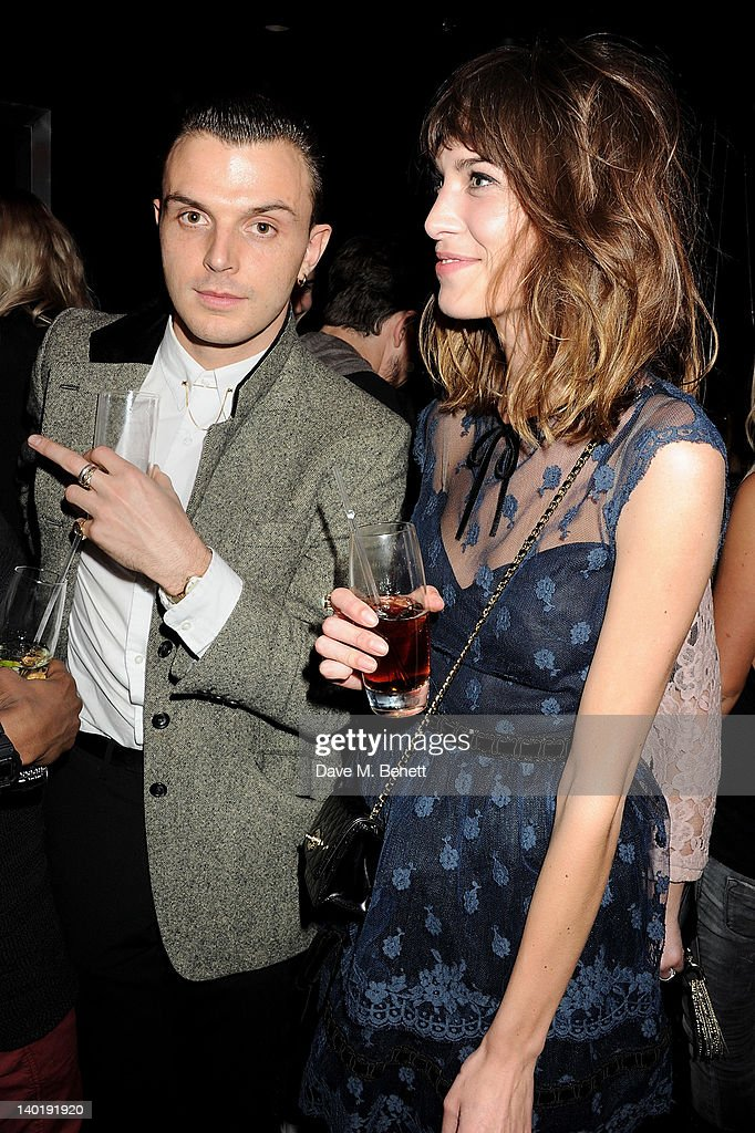 Theo Hutchcraft (L) and Alexa Chung attend the Wyld Bar NME Awards after party at W London Leicester Square on February 29, 2012 in London, England.