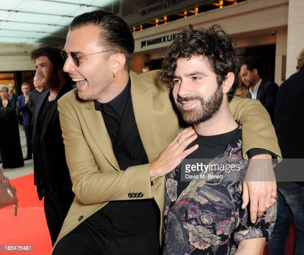 Theo Hutchcraft and Yannis Philippakis arrive at The Q Awards at The Grosvenor House Hotel on October 21 2013 in London England