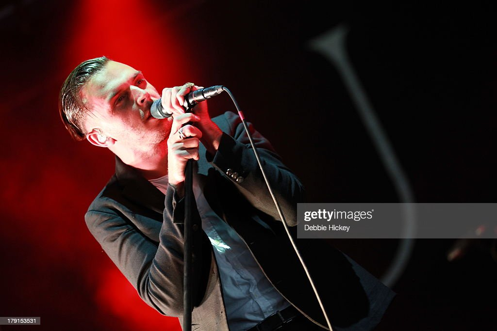 <a gi-track='captionPersonalityLinkClicked' href=/galleries/search?phrase=Theo+Hutchcraft&family=editorial&specificpeople=6963475 ng-click='$event.stopPropagation()'>Theo Hutchcraft</a> of Hurts performs at Day 2 of Electric Picnic at Stradbally Hall Estate on August 31, 2013 in Dublin, Ireland.