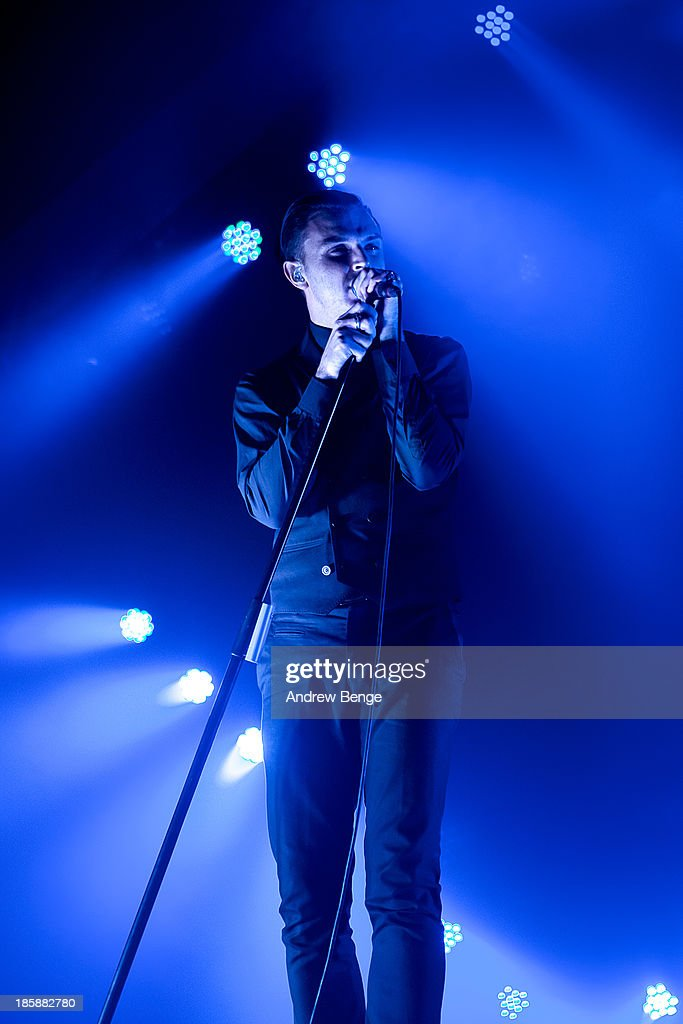 <a gi-track='captionPersonalityLinkClicked' href=/galleries/search?phrase=Theo+Hutchcraft&family=editorial&specificpeople=6963475 ng-click='$event.stopPropagation()'>Theo Hutchcraft</a> of Hurts performs on stage at Manchester Apollo on October 25, 2013 in Manchester, England.