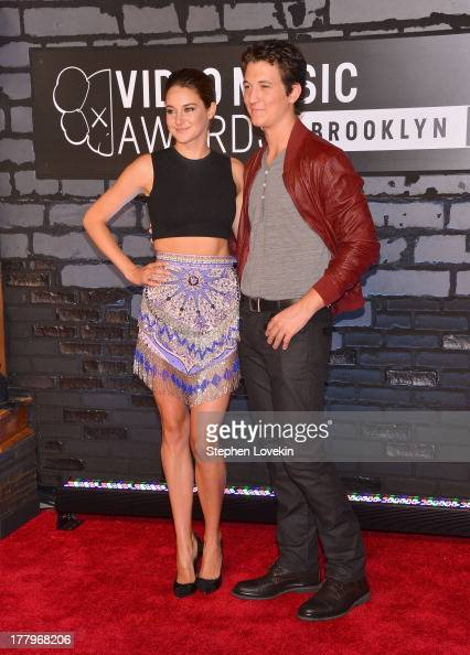 Theo James and Shailene Woodley attend the 2013 MTV Video Music Awards at the Barclays Center on August 25 2013 in the Brooklyn borough of New York...