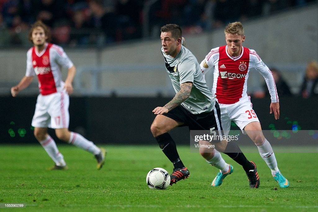 Theo Janssen of Vitesse, Viktor Fischer of Ajax during the Dutch Eredivisie match between Ajax Amsterdam and Vitesse Arnhem at the Amsterdam Arena on November 3, 2012 in Amsterdam, The Netherlands.