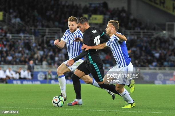 Theo of Real Madrid duels for the ball with Illarramendi and Sergio Canales of Real Sociedad during the Spanish league football match between Real...