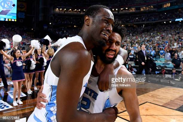 Theo Pinson and Joel Berry II of the North Carolina Tar Heels embrace after time expires during the 2017 NCAA Men's Final Four National Championship...