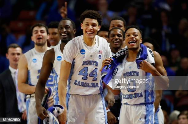 Theo Pinson Justin Jackson Nate Britt of the North Carolina Tar Heels and teammate cheer from the bench in the second half against the Texas Southern...