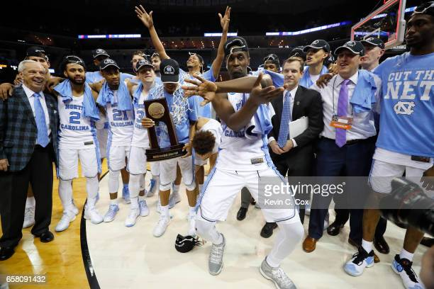 Theo Pinson of the North Carolina Tar Heels celebrates with his team after defeating the Kentucky Wildcats during the 2017 NCAA Men's Basketball...