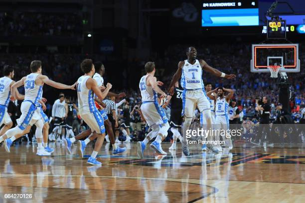 Theo Pinson of the North Carolina Tar Heels celebrates with teammates after defeating the Gonzaga Bulldogs during the 2017 NCAA Men's Final Four...
