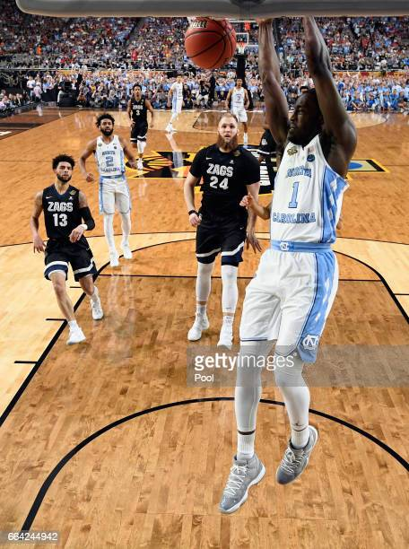 Theo Pinson of the North Carolina Tar Heels dunks in the first half against Przemek Karnowski of the Gonzaga Bulldogs during the 2017 NCAA Men's...