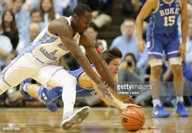 Theo Pinson of the North Carolina Tar Heels goes after a loose ball against Grayson Allen of the Duke Blue Devils during their game at the Dean Smith...