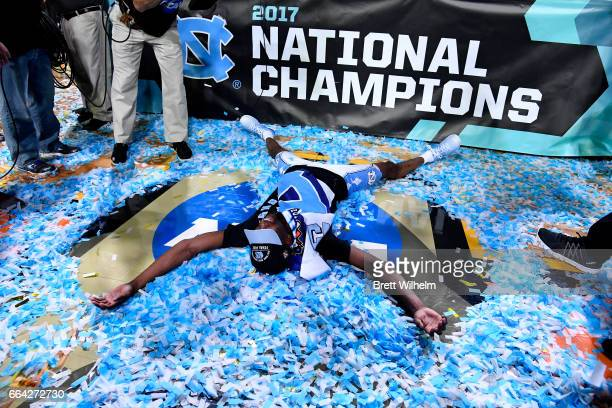 Theo Pinson of the North Carolina Tar Heels makes a confetti angel after time expired during the 2017 NCAA Men's Final Four National Championship...