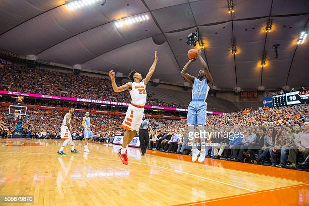 Theo Pinson of the North Carolina Tar Heels shoots the ball from three point range as Malachi Richardson of the Syracuse Orange defends during the...
