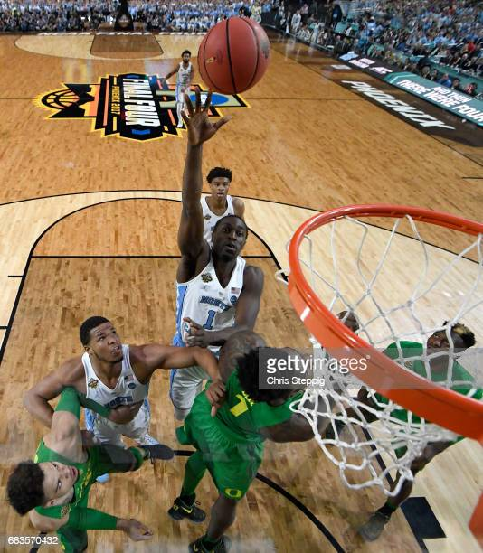 Theo Pinson of the North Carolina Tar Heels shoots the ball over Jordan Bell of the Oregon Ducks during the 2017 NCAA Men's Final Four Semifinal at...