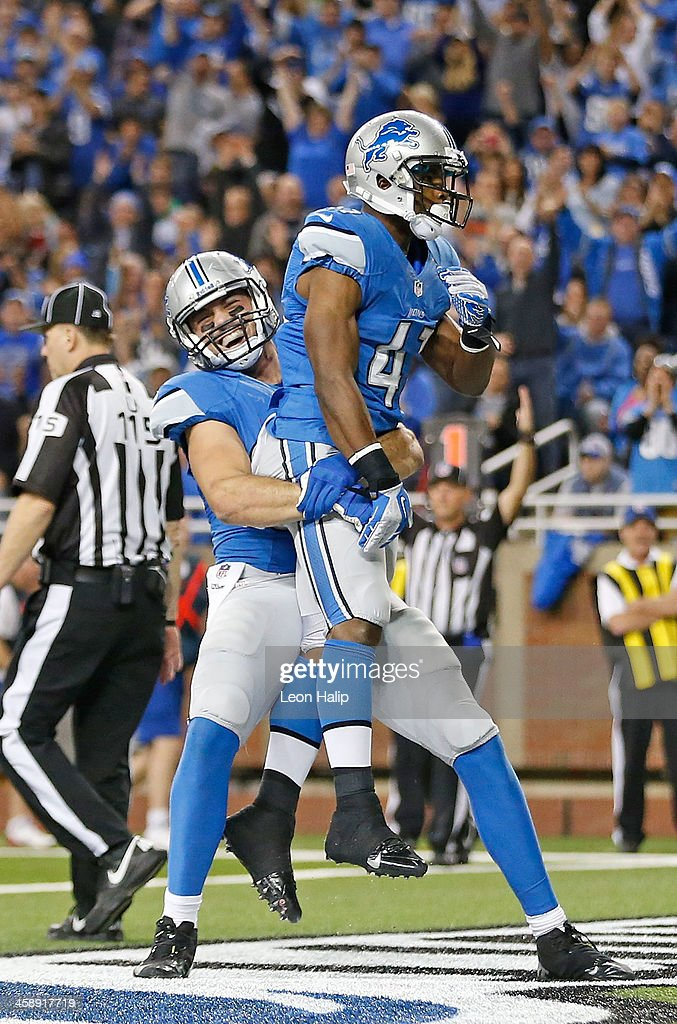 Theo Riddick #41 of the Detroit Lions celebrates after scoring on a short run with teammate Joseph Fauria #80 during the fourth quarter of the game againsts the New York Giants at Ford Field on December 22, 2013 in Detroit, Michigan.