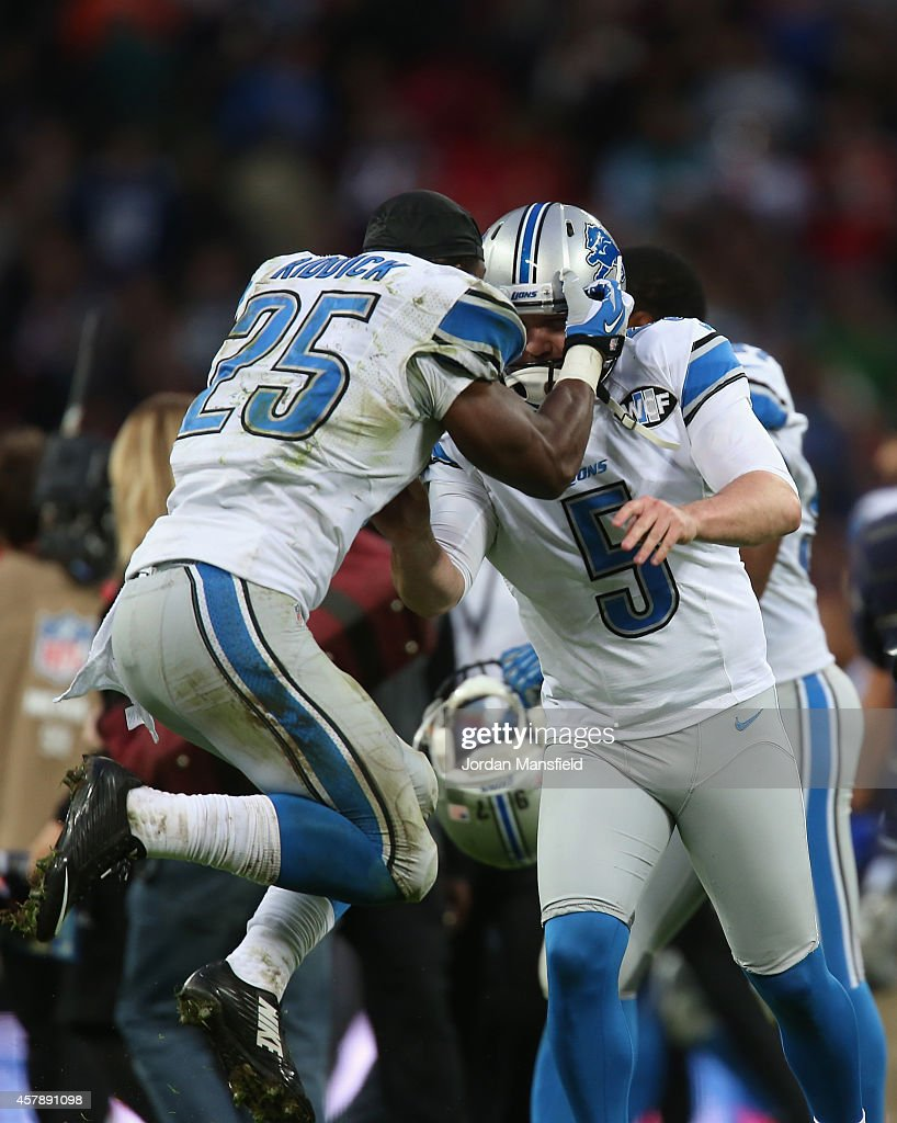 jerseys theo riddick 25 of the detroit lions celebrates with matt prater 5 of the nike