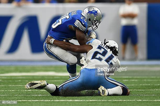 Theo Riddick of the Detroit Lions is brought down by Daimion Stafford of the Tennessee Titans during a game at Ford Field on September 18 2016 in...
