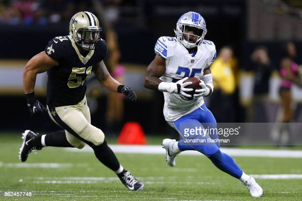 Theo Riddick of the Detroit Lions runs with the ball as Manti Te'o of the New Orleans Saints defends during a game at the MercedesBenz Superdome on...