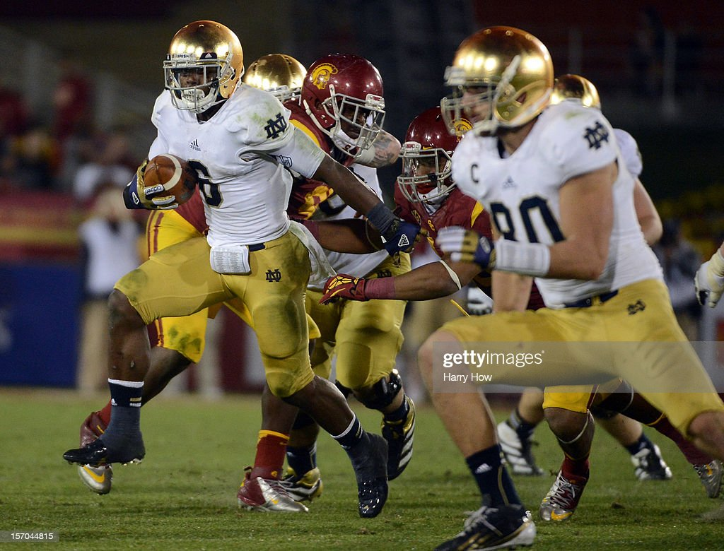 Theo Riddick #6 of the Notre Dame Fighting Irish rushes during a 22-13 win over the USC Trojans at Los Angeles Memorial Coliseum on November 24, 2012 in Los Angeles, California.