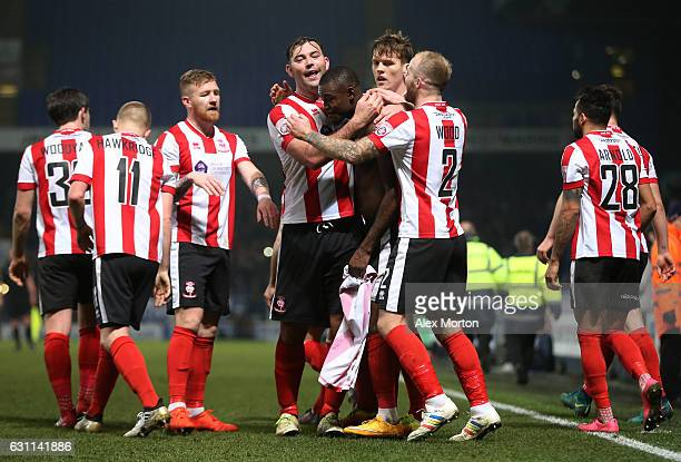 Theo Robinson of Lincoln City celebrates with team mates after scoring his sides second goal during the Emirates FA Cup third round match between...
