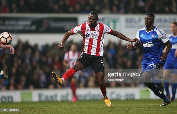 Theo Robinson of Lincoln City scores his sides second goal during the Emirates FA Cup third round match between Ipswich Town and Lincoln City at...