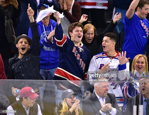 Theo Rossi Ansel Elgort and guest attend the Washington Capitals vs New York Rangers game at Madison Square Garden on May 13 2015 in New York City