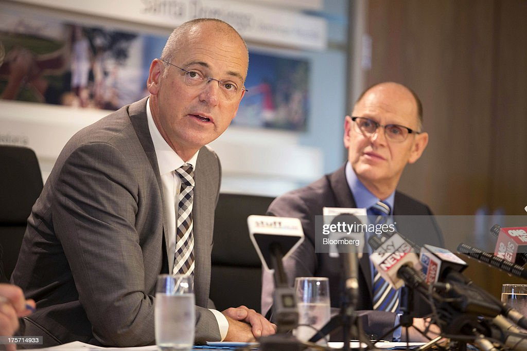 Theo Spierings, chief executive officer of Fonterra Cooperative Group Ltd., left, speaks during a news conference in Auckland, New Zealand, on Wednesday, Aug. 7, 2013. Fonterra said all dairy product affected by a potentially contaminated ingredient has been located and removed from the market. Photographer: Brendon O'Hagan/Bloomberg via Getty Images