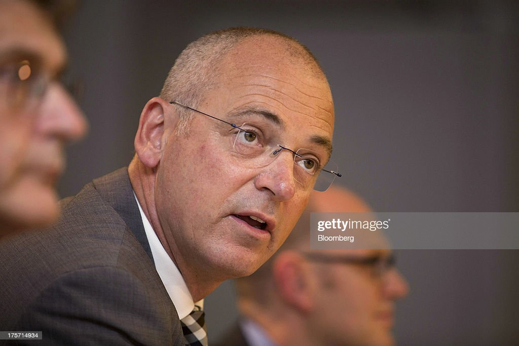 Theo Spierings, chief executive officer of Fonterra Cooperative Group Ltd., center, speaks during a news conference in Auckland, New Zealand, on Wednesday, Aug. 7, 2013. Fonterra said all dairy product affected by a potentially contaminated ingredient has been located and removed from the market. Photographer: Brendon O'Hagan/Bloomberg via Getty Images