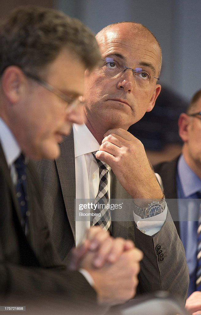 Theo Spierings, chief executive officer of Fonterra Cooperative Group Ltd., center, attends a news conference in Auckland, New Zealand, on Wednesday, Aug. 7, 2013. Fonterra said all dairy product affected by a potentially contaminated ingredient has been located and removed from the market. Photographer: Brendon O'Hagan/Bloomberg via Getty Images