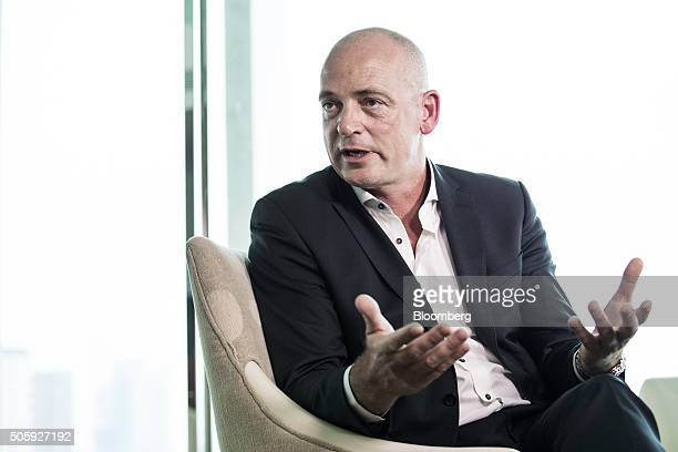 Theo Spierings chief executive officer of Fonterra Cooperative Group Ltd gestures as he speaks during an interview in Singapore on Tuesday Jan 19...