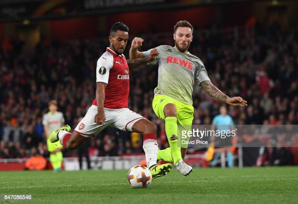 Theo Walccott of Arsenal shoots under pressure from Jorge Mere of Koeln during the UEFA Europa League group H match between Arsenal FC and 1 FC Koeln...