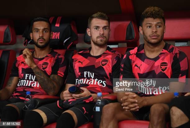 Theo Walcott Aaron Ramsey and Alex OxladeChamberlain of Arsenal before the match between Bayern Munich and Arsenal at Shanghai Stadium on July 19...