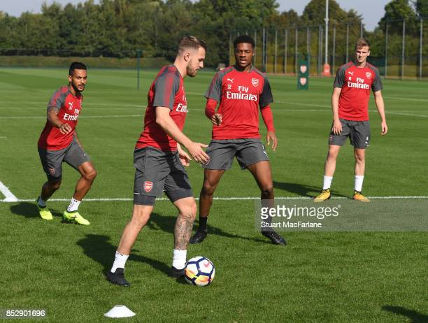 Theo Walcott Aaron Ramsey and Chaba Akpom of Arsenal during a training session at London Colney on September 24 2017 in St Albans England