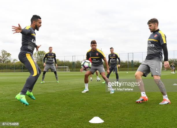 Theo Walcott Alex OxladeChamberlain and Aaron Ramsey of Arsenal during a training session at London Colney on April 29 2017 in St Albans England