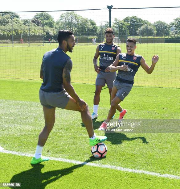 Theo Walcott Alex OxladeChamberlain and Alexis Sanchez of Arsenal during a training session at London Colney on May 26 2017 in St Albans England