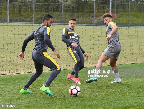 Theo Walcott Alexis Sanchez and Alex OxladeChamberlain of Arsenal during a training session at London Colney on April 22 2017 in St Albans England