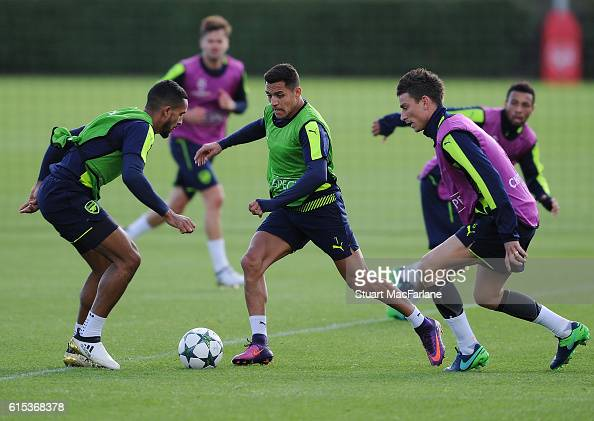 Theo Walcott Alexis Sanchez and Laurent Koscielny of Arsenal during a training session at London Colney on October 18 2016 in St Albans England