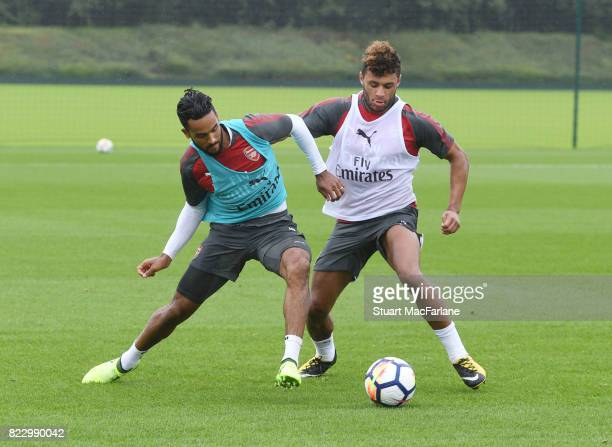 Theo Walcott and Alex OxladeChamberlain of Arsenal during a training session at London Colney on July 26 2017 in St Albans England