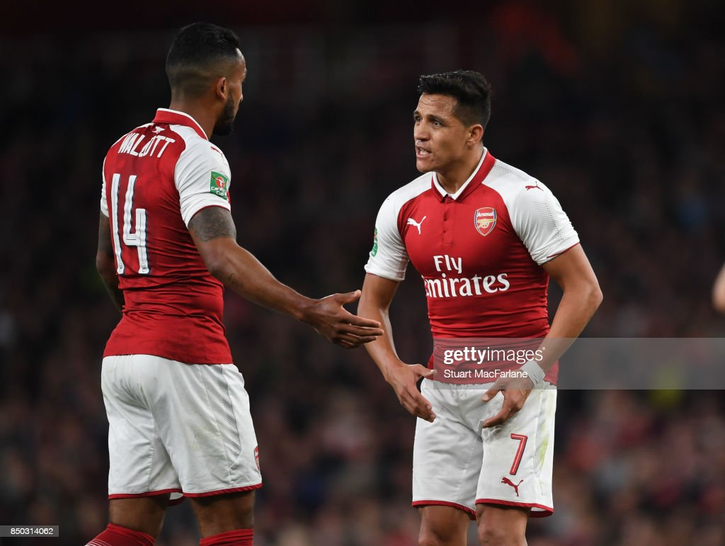 Theo Walcott and Alexis Sanchez of Arsenal during the Carabao Cup Third Round match between Arsenal and Doncaster Rovers at Emirates Stadium on September 19, 2017 in London, England.