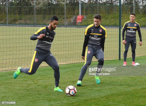 Theo Walcott and Gabriel of Arsenal during a training session at London Colney on April 22 2017 in St Albans England