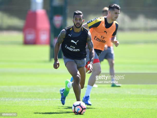Theo Walcott and Granit Xhaka of Arsenal during a training session at London Colney on May 26 2017 in St Albans England