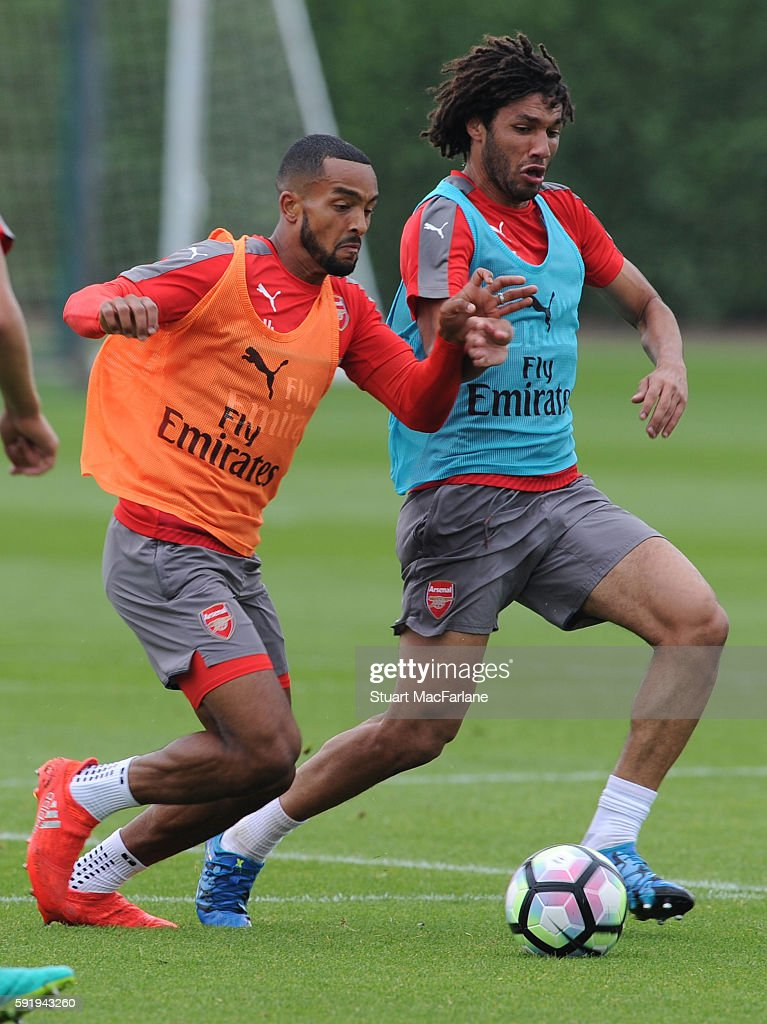 Theo Walcott and Mohamed Elneny of Arsenal during a training session at London Colney on August 19 2016 in St Albans England