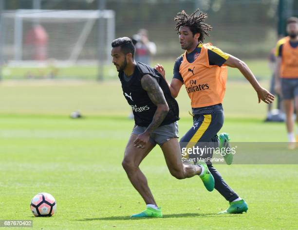 Theo Walcott and Mohamed Elneny of Arsenal during a training session at London Colney on May 24 2017 in St Albans England