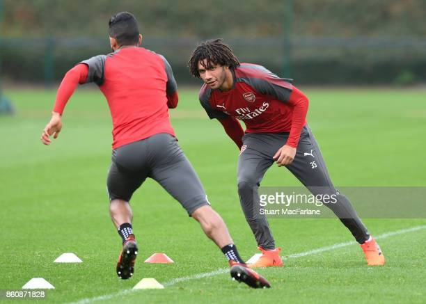 Theo Walcott and Mohamed Elneny of Arsenal during a training session at London Colney on October 13 2017 in St Albans England